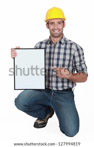 craftsman pointing at a blank board - stock photo