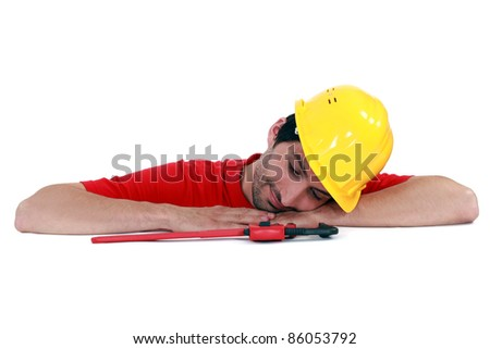 craftsman relaxing on a table - stock photo