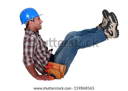 craftsman sitting on the floor - stock photo