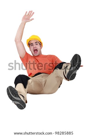 craftsman slipping and falling on the floor - stock photo