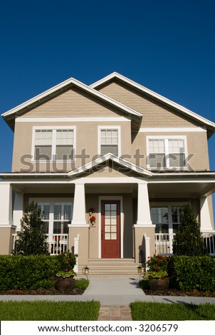 craftsman-styled bungalow in small American town - stock photo
