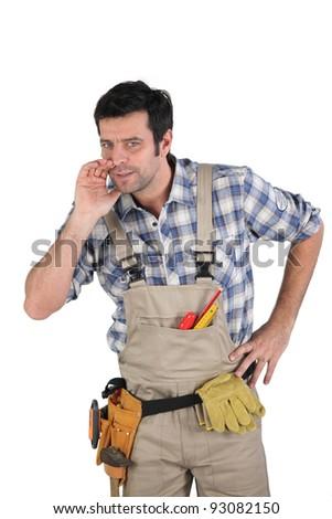 craftsman telling a secret - stock photo