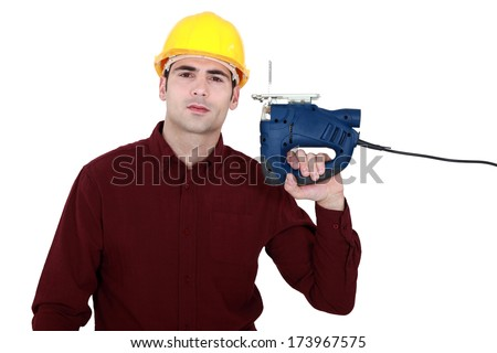 Craftsman with a chainsaw - stock photo