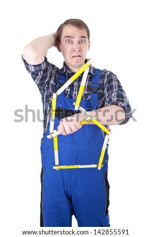Craftsman with yardstick in panic - stock photo