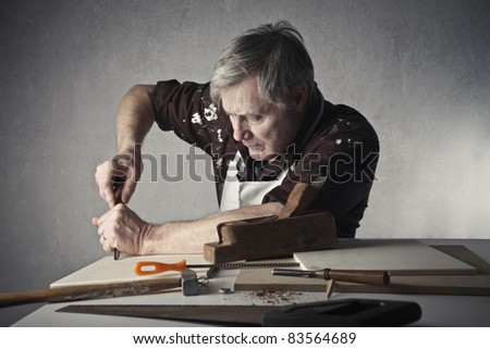 Craftsman working some wood boards - stock photo