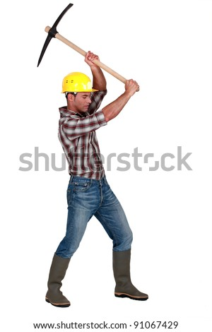 craftsman working with a pick - stock photo