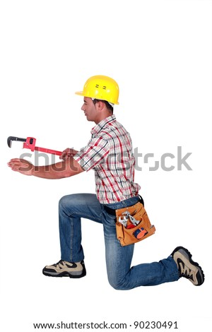 craftsman working with a spanner - stock photo