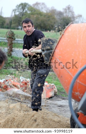 craftsmen making cement - stock photo
