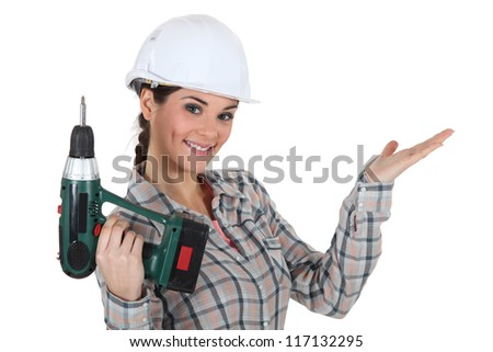 craftswoman holding a drill - stock photo