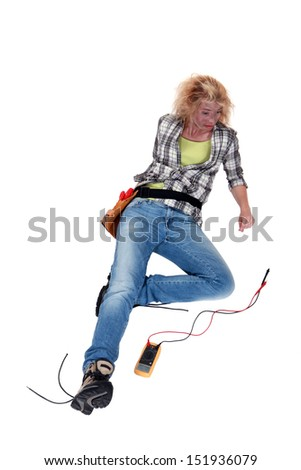 craftswoman lying down after an electric shock - stock photo