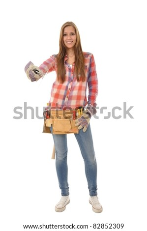 Craftswoman with a checkered shirt with a spatula stands Model - stock photo
