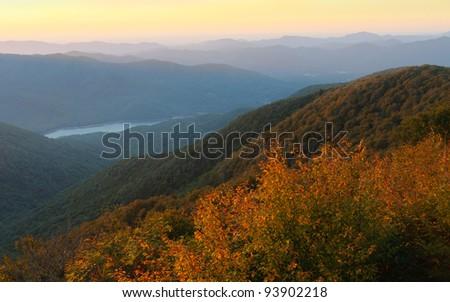 Craggy Gardens overlook and Burnett Reservoir of mountains at sunrise - stock photo