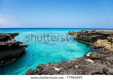 Craggy ironshore  formation limestone rocks at the edge of Smith Cove, Grand Cayman - stock photo