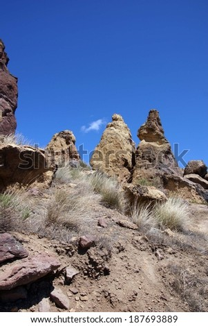 Craggy rhyolite ridge along the Crooked River at Smith Rock State Park, Central Oregon  - stock photo