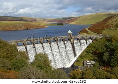 Craig Goch reservoir with water overflowing, Elan Valley, Wales. - stock photo
