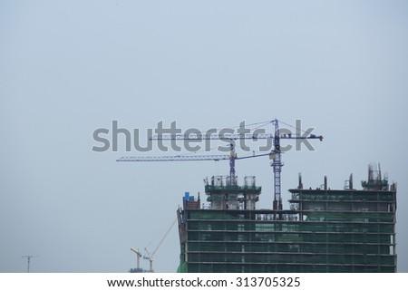Crains under construction building - stock photo