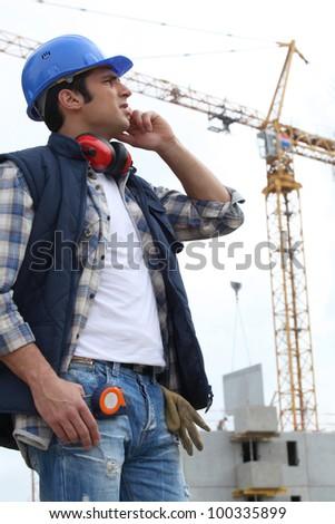 Cran on construction site - stock photo