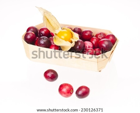 Cranberries and ground-cherry in a basket - stock photo