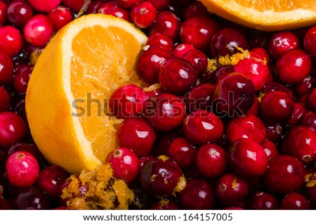 Cranberries and orange for making homemade cranberry sauce - stock photo