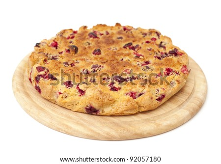 cranberries cake on a wooden board isolated - stock photo