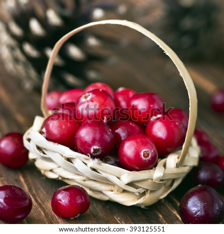 Cranberries in a decorative basket. Selective focus - stock photo