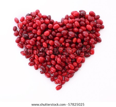 cranberries in heart shape over white background - stock photo