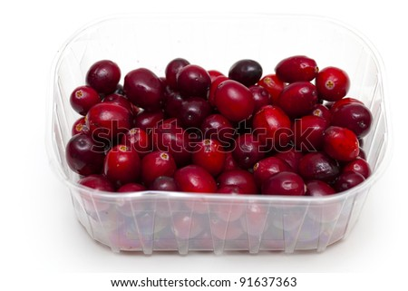 cranberries in plastic box isolated over white