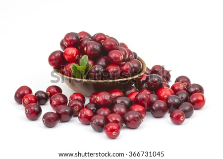 Cranberries in wooden bowl on white background. - stock photo