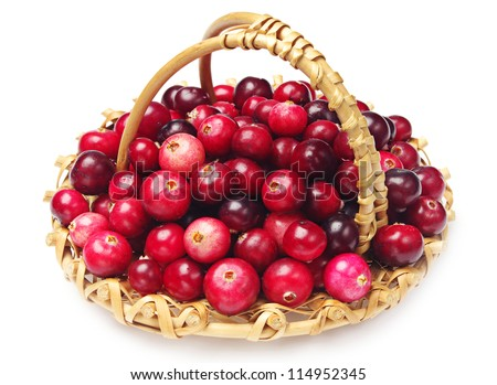 Cranberries with basket on white - stock photo