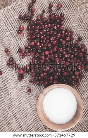 cranberries with sugar on sacking - stock photo