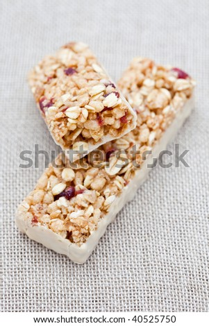 Cranberry energy bar on a hessian cloth - stock photo