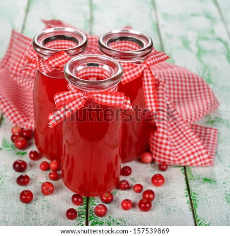 cranberry juice in glass bottles on a white background - stock photo
