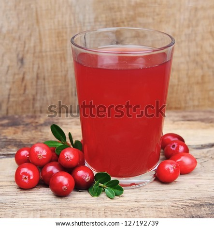 Cranberry juice on wooden table - stock photo
