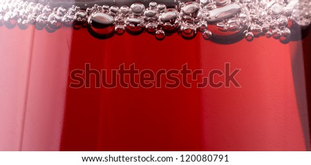 Cranberry juice with air bubbles macro isolated on white background - stock photo