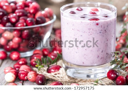 Cranberry Milkshake with fresh fruits - stock photo