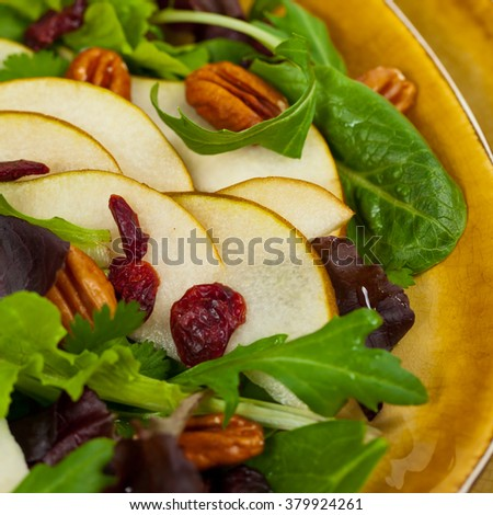 Cranberry Pear Salad with Pecans. Macro with shallow dof. Selective focus. - stock photo
