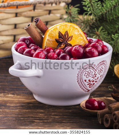 Cranberry sauce in ceramic saucepan on dark background. Selective focus - stock photo