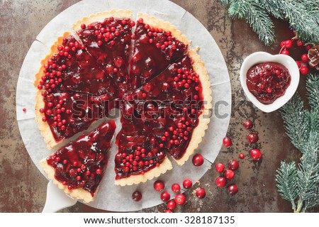 Cranberry Tart. Delicious cranberry tart with jellied and fresh cranberries for Christmas. Top view, vintage toned