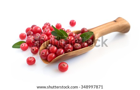 Cranberry with wooden scoop isolated over white - stock photo