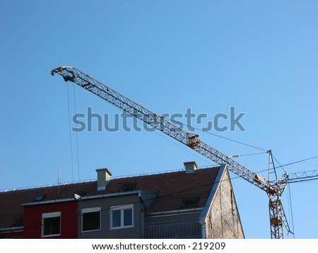 crane above a building during construction