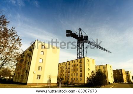 Crane and building - stock photo