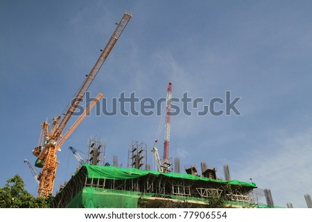 Crane and building construction - stock photo