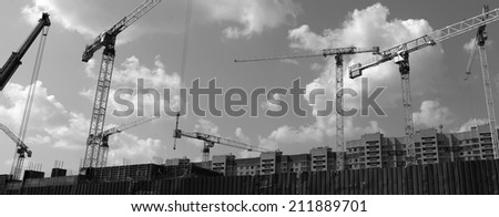 Crane and building construction construction site black and white photography