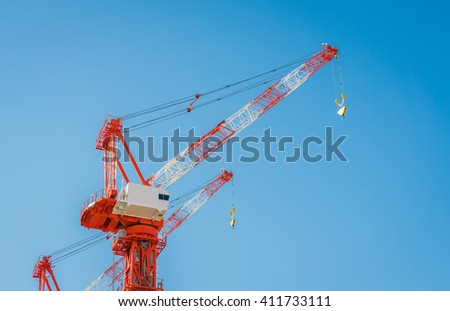 Crane and building construction site - stock photo