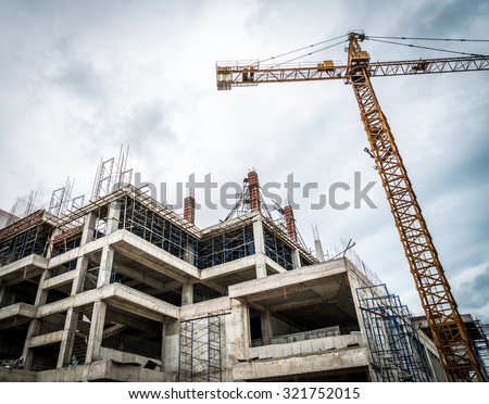 Crane and building construction site ( Filtered image processed vintage effect. ) - stock photo