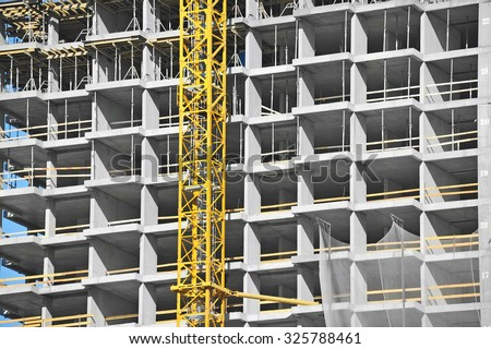 Crane and building construction site with balcony