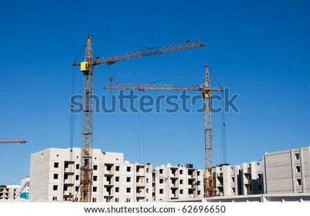 crane and building under construction on the skyline - stock photo