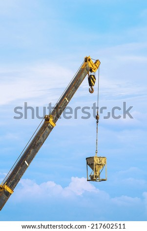 Crane and cargo with blue sky - stock photo
