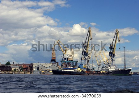 Crane and container in port.