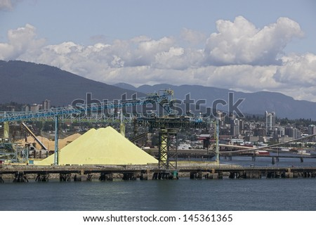 Crane and materials for transportation in Vancouver Harbour British Columbia - stock photo